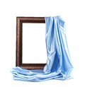 Wooden frame with blue silk on a white background Stock Images