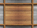 Wooden frame with four ropes background a Stock Photos
