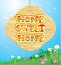 Wooden frame with home sweet home words on sky ba background art Royalty Free Stock Photo