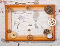Wooden frame and mechanical clock gears on the old table Stock Photos