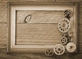 Wooden frame and mechanical clock gears on the old table Royalty Free Stock Photos