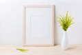 Wooden frame mockup with ornamental grass in exquisite vase Royalty Free Stock Photo