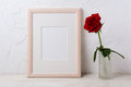 Wooden frame mockup with red rose in glass vase Royalty Free Stock Photo