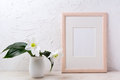 Wooden frame mockup with white lily in flower pot Royalty Free Stock Photo