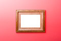 Wooden frame painted in gold color mounted on wall Royalty Free Stock Photo