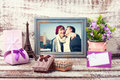 Wooden Frame with picture of young couple and romantic accessori Royalty Free Stock Photo