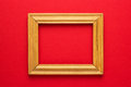 Wooden frame on red Royalty Free Stock Photo