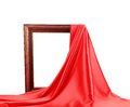 Wooden frame with red silk on a white background Royalty Free Stock Images