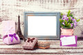 Wooden Frame and romantic accessories Royalty Free Stock Photo