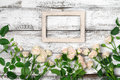 Wooden frame with roses Royalty Free Stock Photo