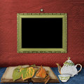 The wooden frame on the wall and  teapot Stock Photos
