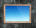 Wooden frame window with view of blue sky Royalty Free Stock Photo