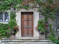 Wooden front door of house with ivy Royalty Free Stock Photo
