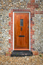 Wooden front door simple set in a cobblestone building Royalty Free Stock Photography