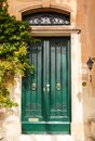 Wooden front door to the house green in mediterranean Stock Image