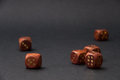 Wooden gambling dices on black background Royalty Free Stock Photo