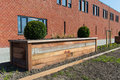Wooden garden bed in front of a new building Stock Images
