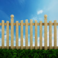 Wooden garden fence against the blue sky Royalty Free Stock Photo