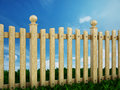 Wooden garden fence against the blue sky Stock Photography