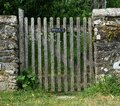Private sign, Wooden Garden Gate & stone wall Royalty Free Stock Photo