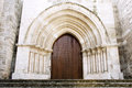Wooden gate of ancient Cathedral Stock Photos