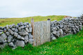 Wooden gate ireland a stone wall with a shot in Royalty Free Stock Image