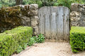 Wooden gate and stone fence in a garden Royalty Free Stock Photo