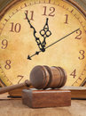 Wooden gavel and clock Royalty Free Stock Photos