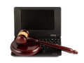 Wooden gavel on a laptop keyboard Royalty Free Stock Photo
