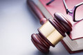 Wooden Gavel Resting on Red Leather Book Royalty Free Stock Photo