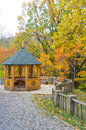 Wooden gazebo beautiful in the park in autumn Stock Images
