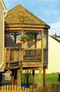 Wooden gazebo on deck with hanging flower basket Royalty Free Stock Photography