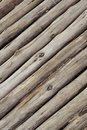 Wooden gray logs background wall slanted boards old weathered rustic pattern design Royalty Free Stock Photo