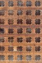 Wooden grille old brown with round holes Stock Image