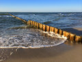 Wooden groynes at the beach of the german baltic sea Royalty Free Stock Photo