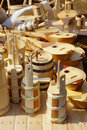 Wooden handcraft stall on village fair with traditional from croatian village of kuterevo tamburica barrels milk pots and pots Royalty Free Stock Image