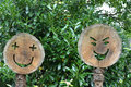 Wooden happy faces carved in round cut wood trunk Royalty Free Stock Photography