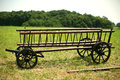 Wooden hay wagon for agricultural use on the farm trolley or cart Stock Image