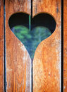 Wooden heart at an antique restroom door Royalty Free Stock Photography