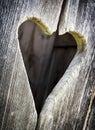 Wooden heart at an antique restroom door Stock Photography