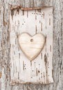 Wooden heart with birch bark on the old wood background Royalty Free Stock Images