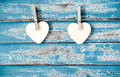 Wooden heart hanging on vintage blue wood background Royalty Free Stock Photo