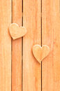 Wooden heart shape on wood plank Royalty Free Stock Photos