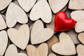 Wooden hearts, on the heart background