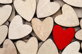 Wooden hearts, one red heart on the heart background
