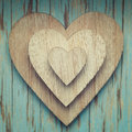 Wooden hearts on top of each other on a turquoise vintage backgr background Royalty Free Stock Images