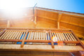 Wooden home balcony under the summer sun lens flare visible Stock Images