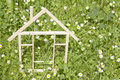 Wooden home in spring green grass ecological building concept Stock Photo