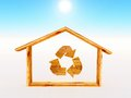 Wooden home woodn house with the recycling symbol inside Stock Image