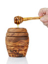 Wooden honey pot with dipper Royalty Free Stock Photo